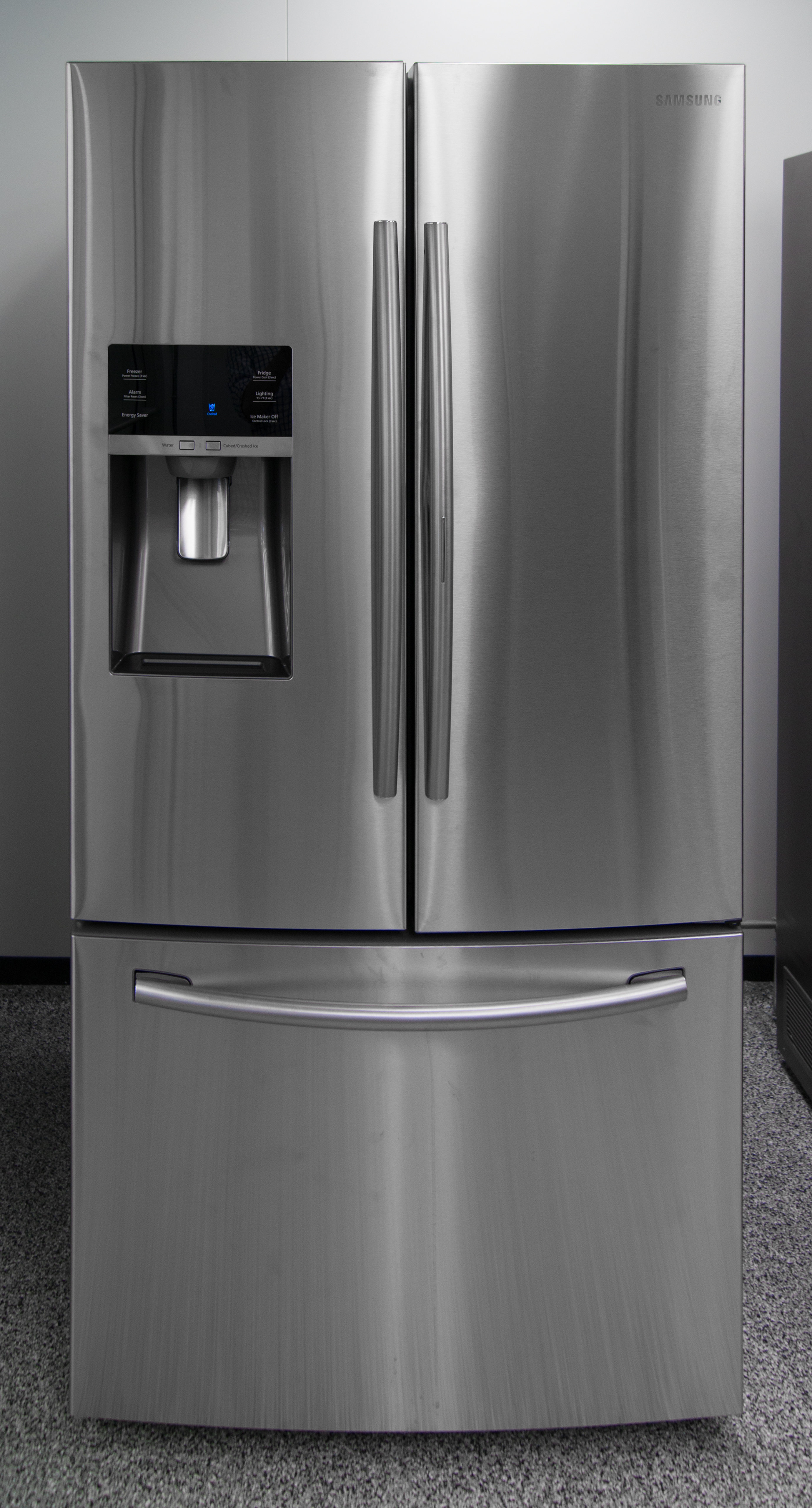 At first glance, the high-end Samsung RF28HDEDBSR French door fridge looks pretty ordinary; the door-in-door access is very subtle.