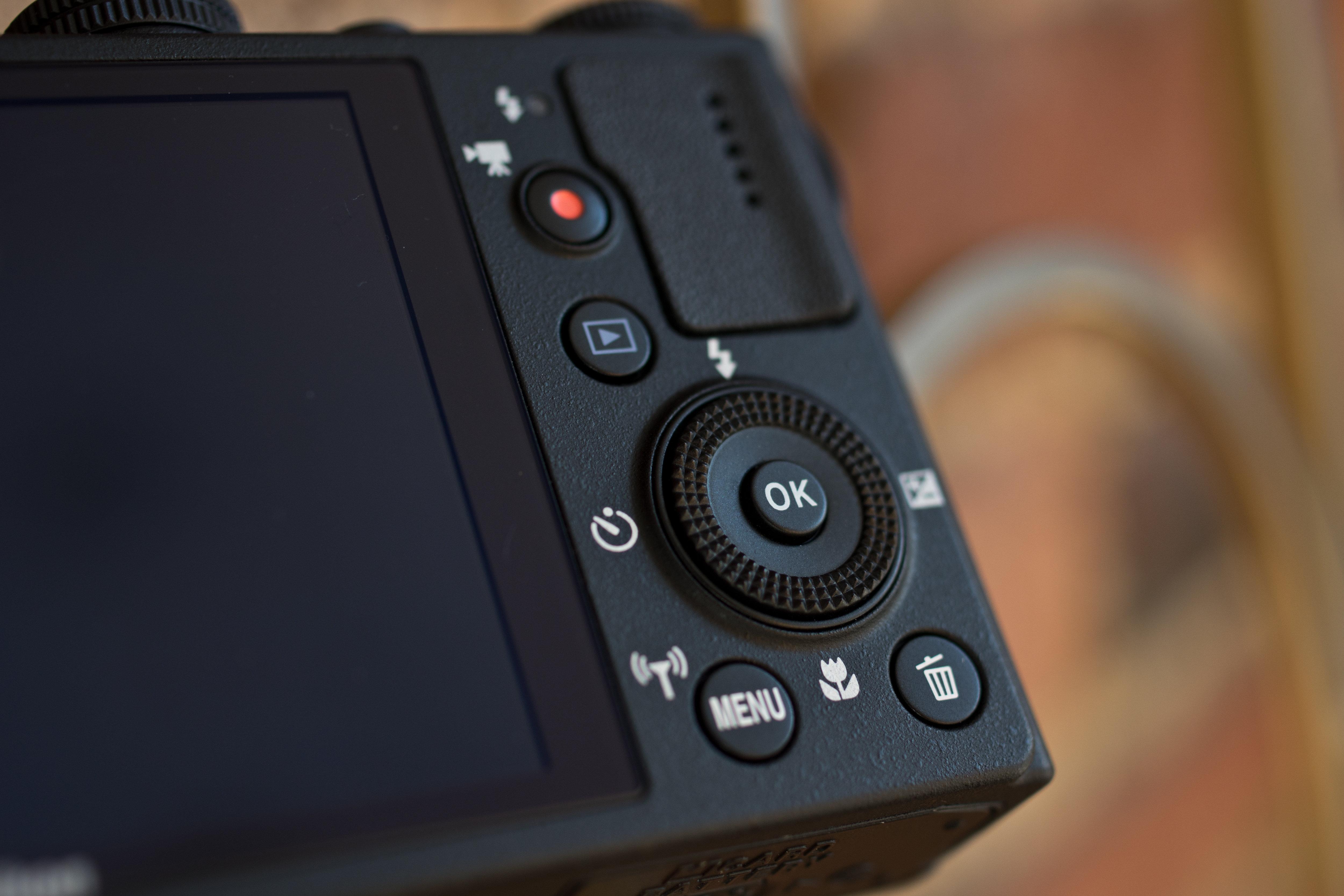 A photograph of the Nikon Coolpix P340's rear controls.