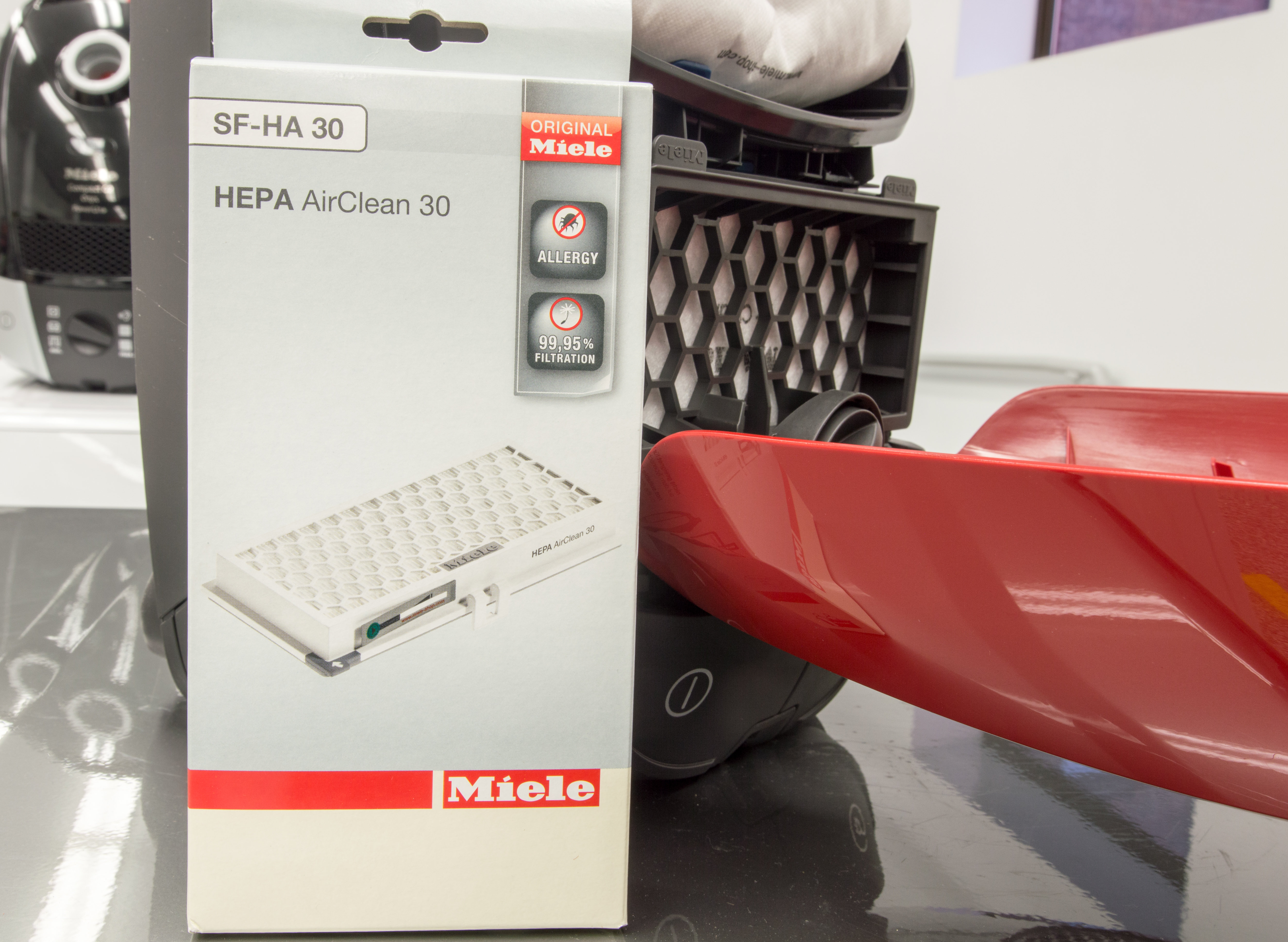 how to change miele hepa filter