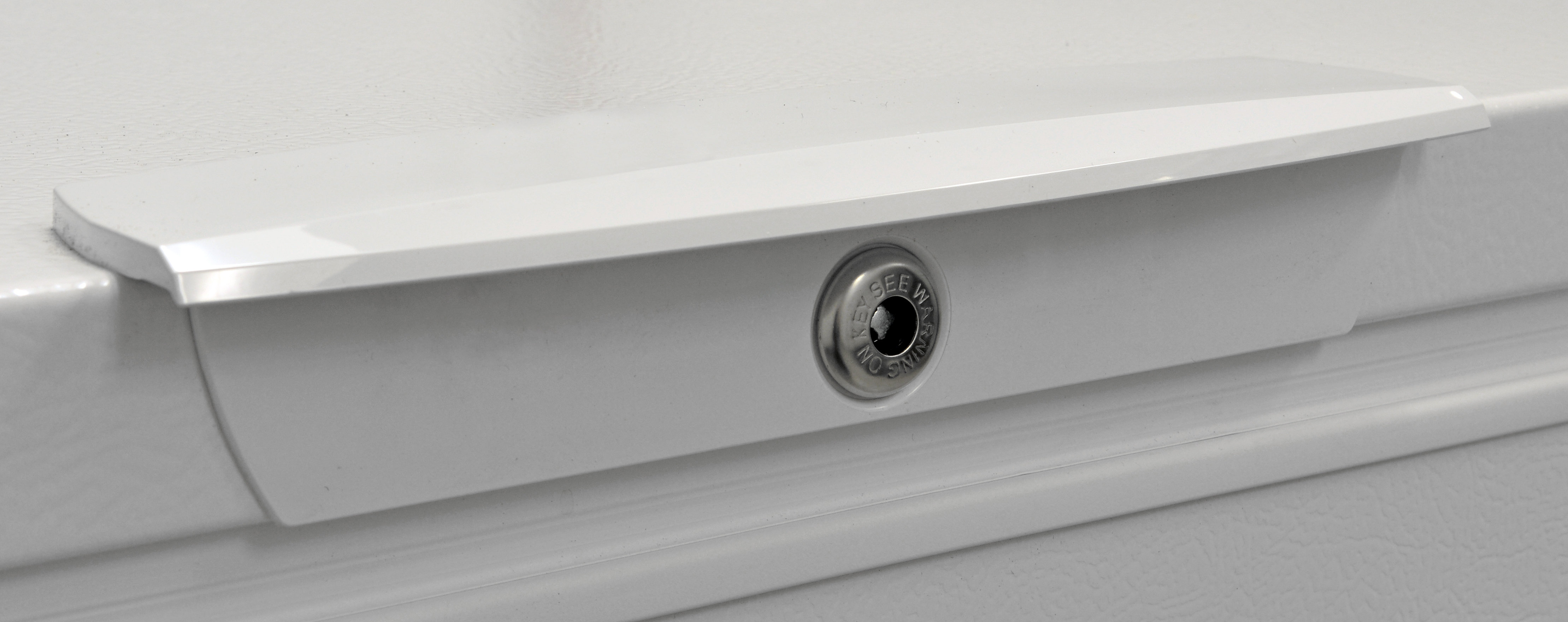 The Frigidaire FFFC16M5QW's door lock is useful in active households for preventing accidental openings.