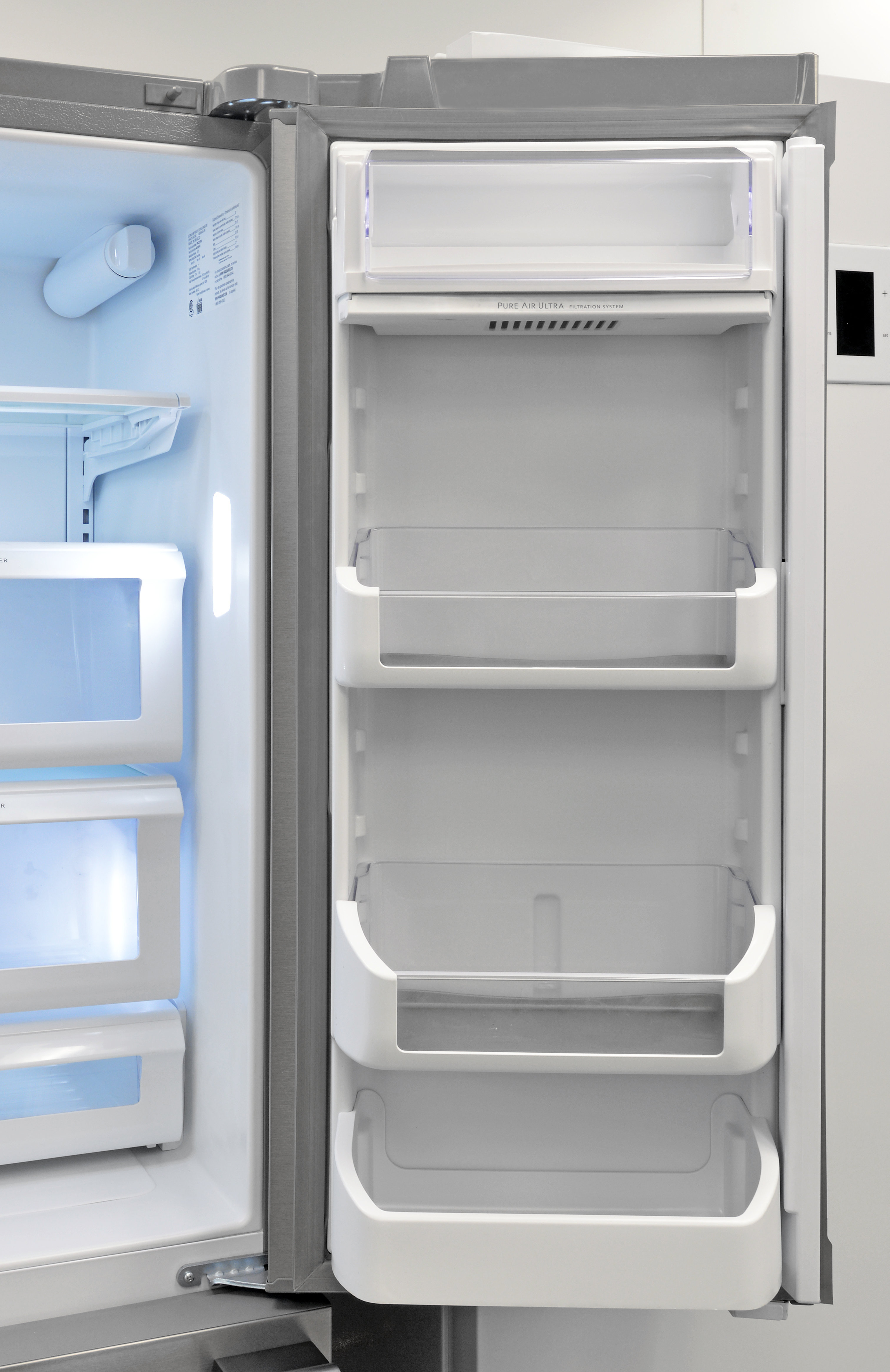 The Frigidaire Professional FPBC2277RF's right-hand door houses large, adjustable, gallon-deep shelves.