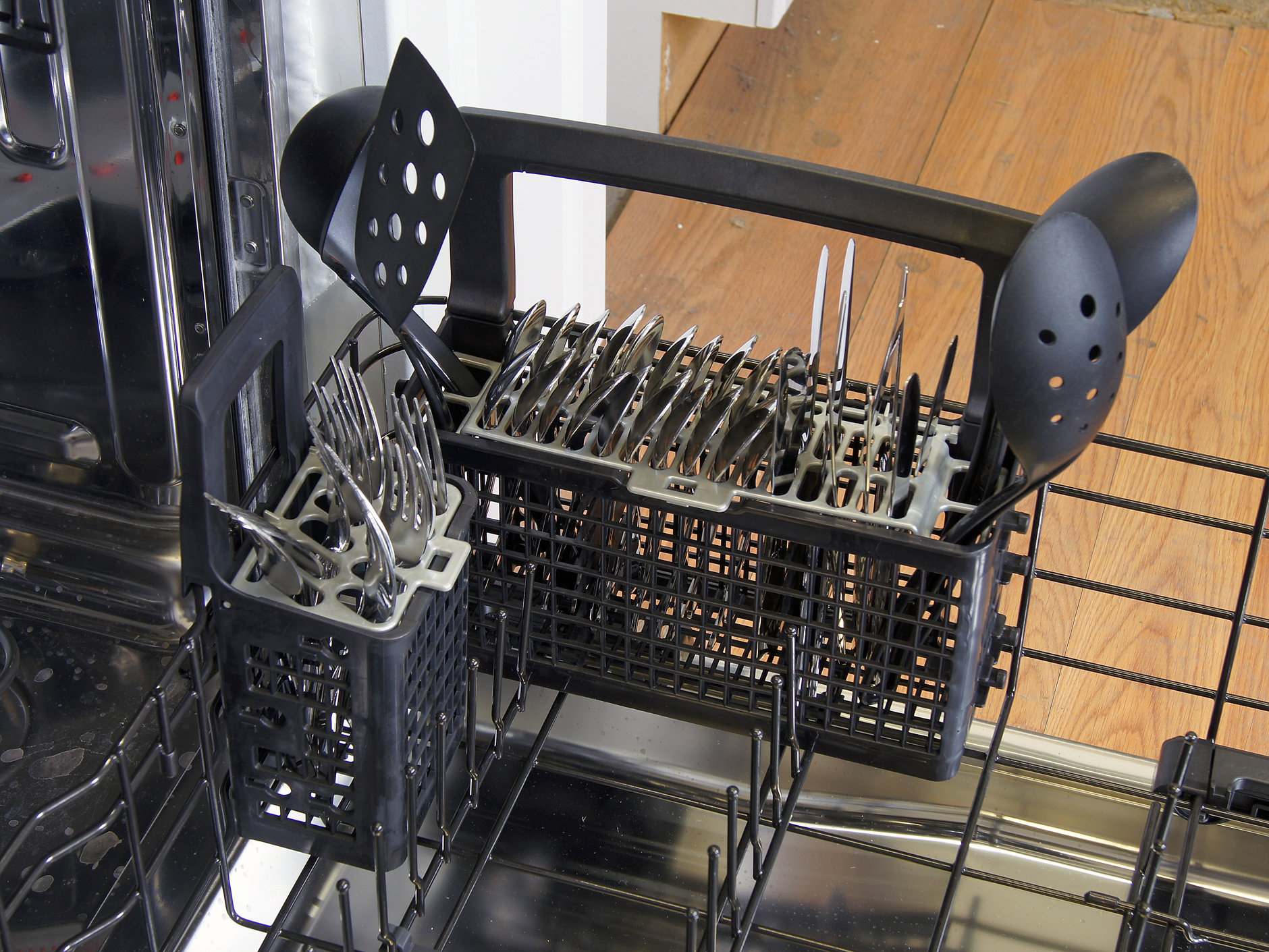 GE Cafe CDT725SSFSS cutlery basket loaded with silverware