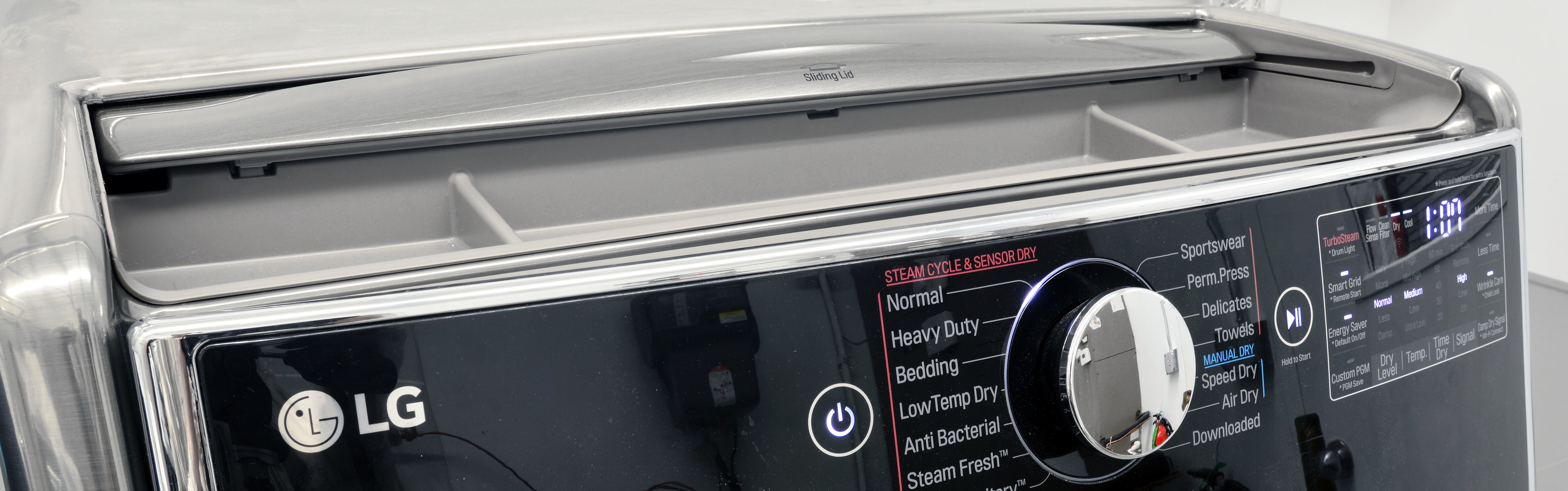 A lid above the LG DLEX5000V's controls can be slid back to reveal some small storage compartments.