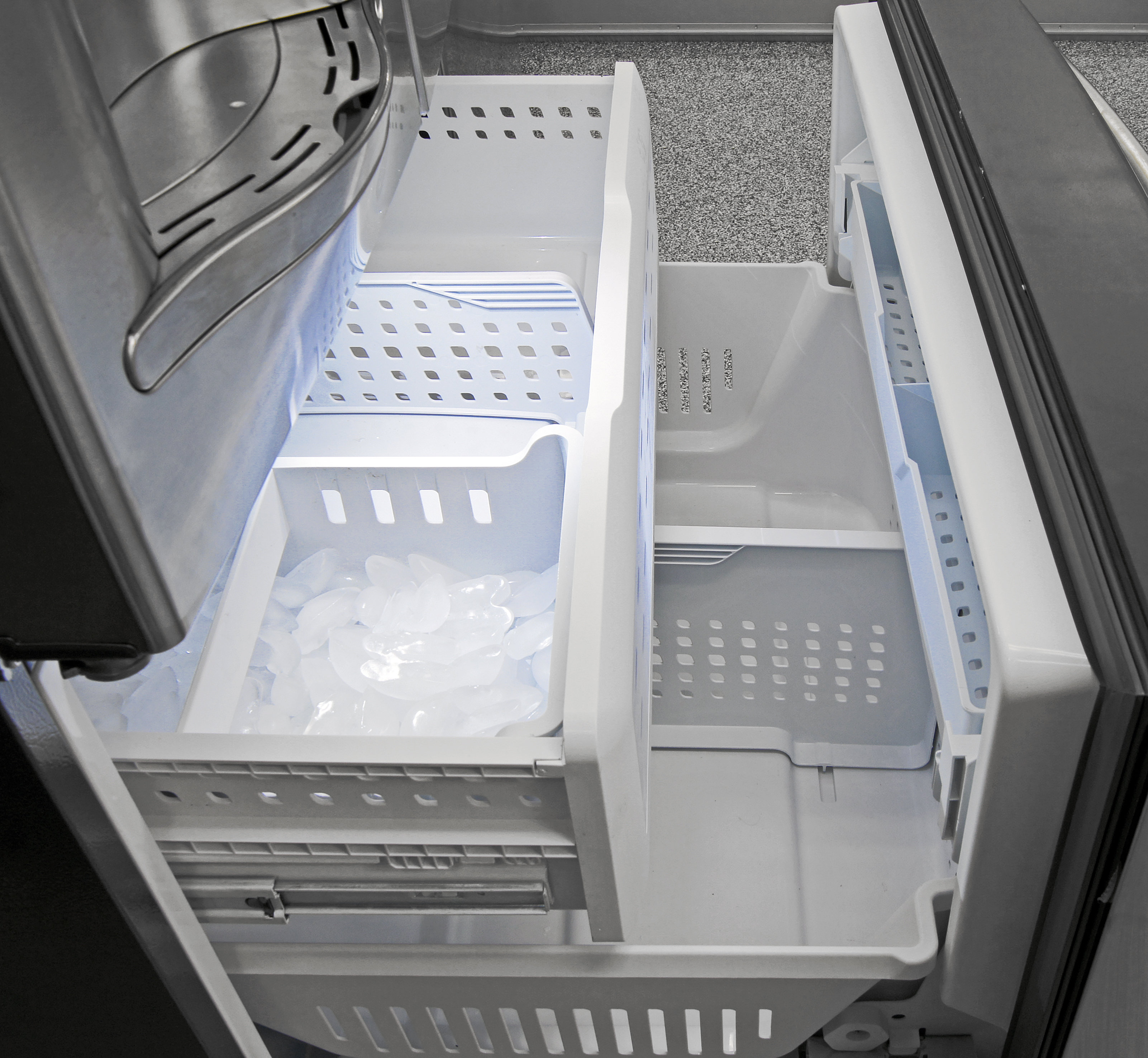 The GE Profile PFE28RSHSS's spacious pull-out freezer also comes with an unusually designed ice bucket.