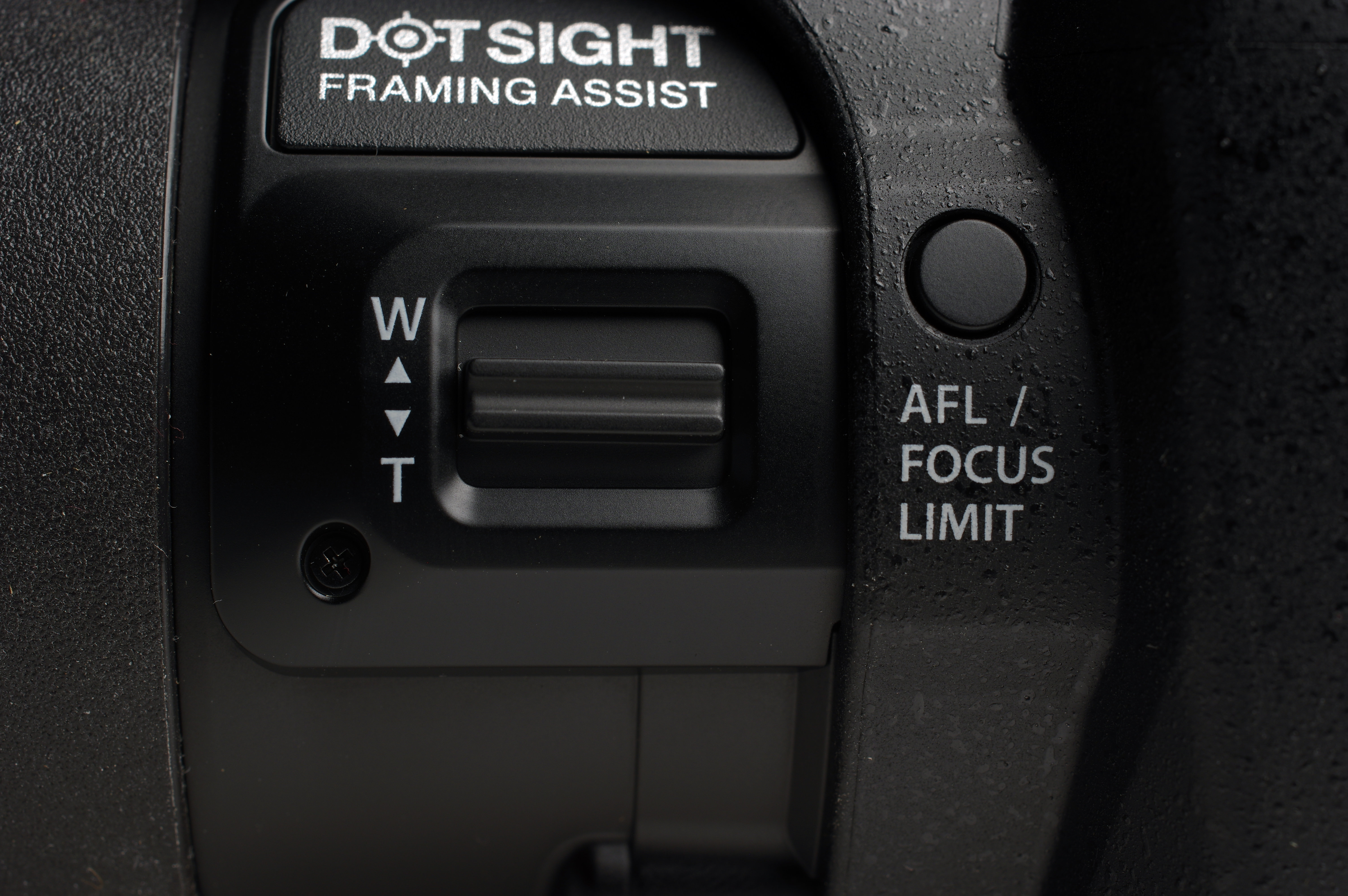 The zoom can be throttled on top by the shutter release or this side control.