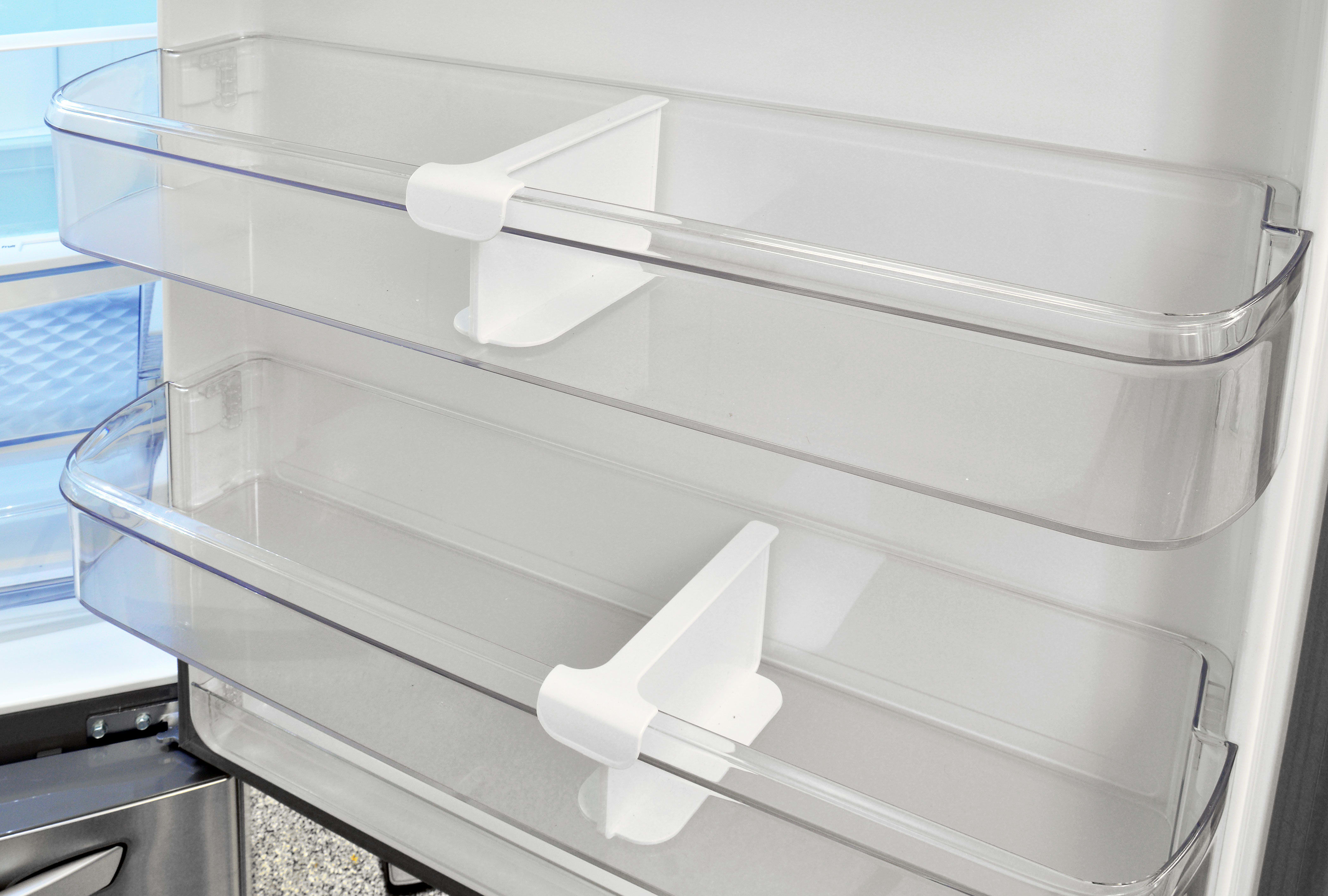 Removable plastic dividers can be slid left or right to help organize the LG LDC24370ST's door storage.