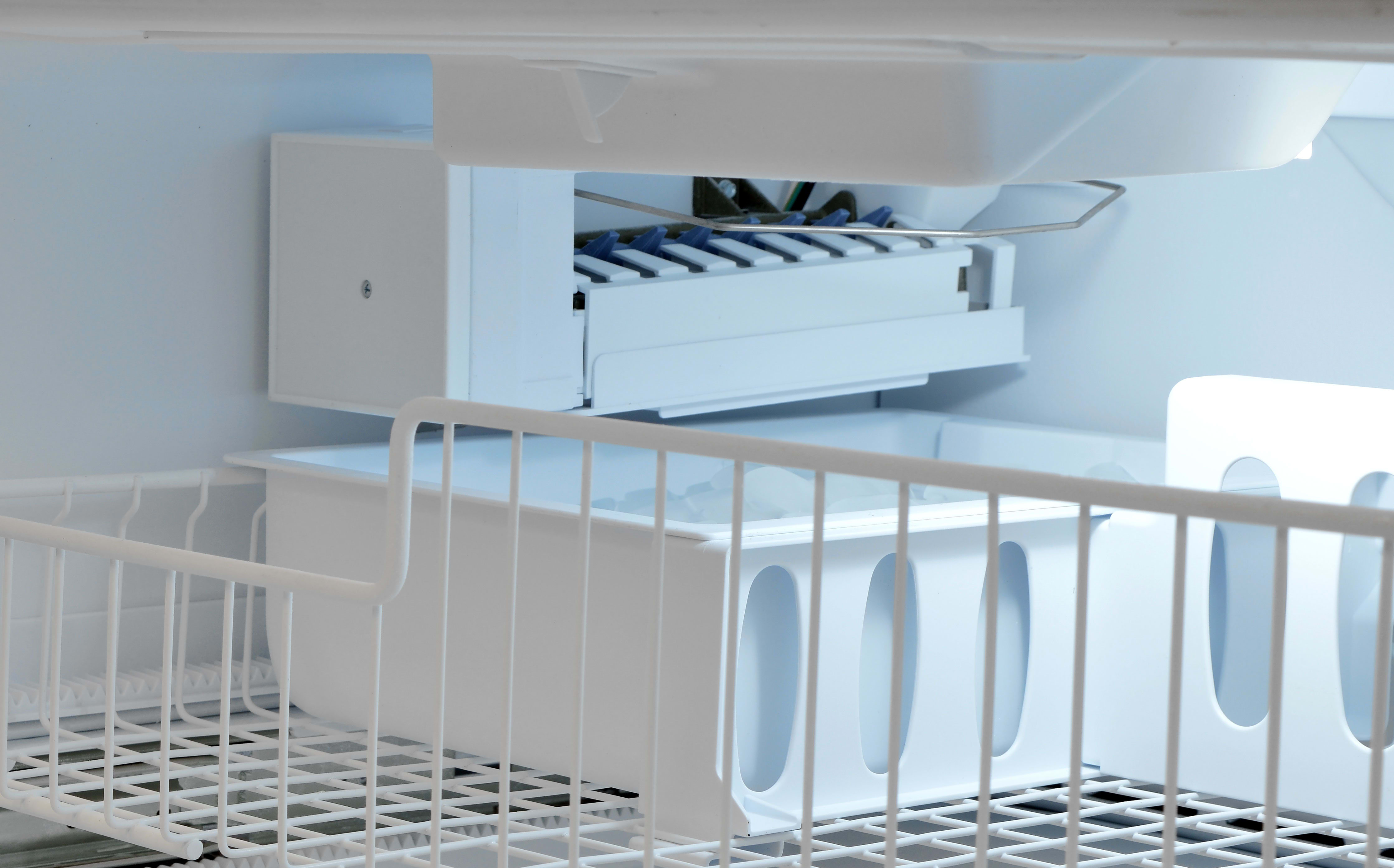 The Whirlpool WRF535SMBM's ice maker is stuck down the freezer, with just a flip wire to turn it on or off.