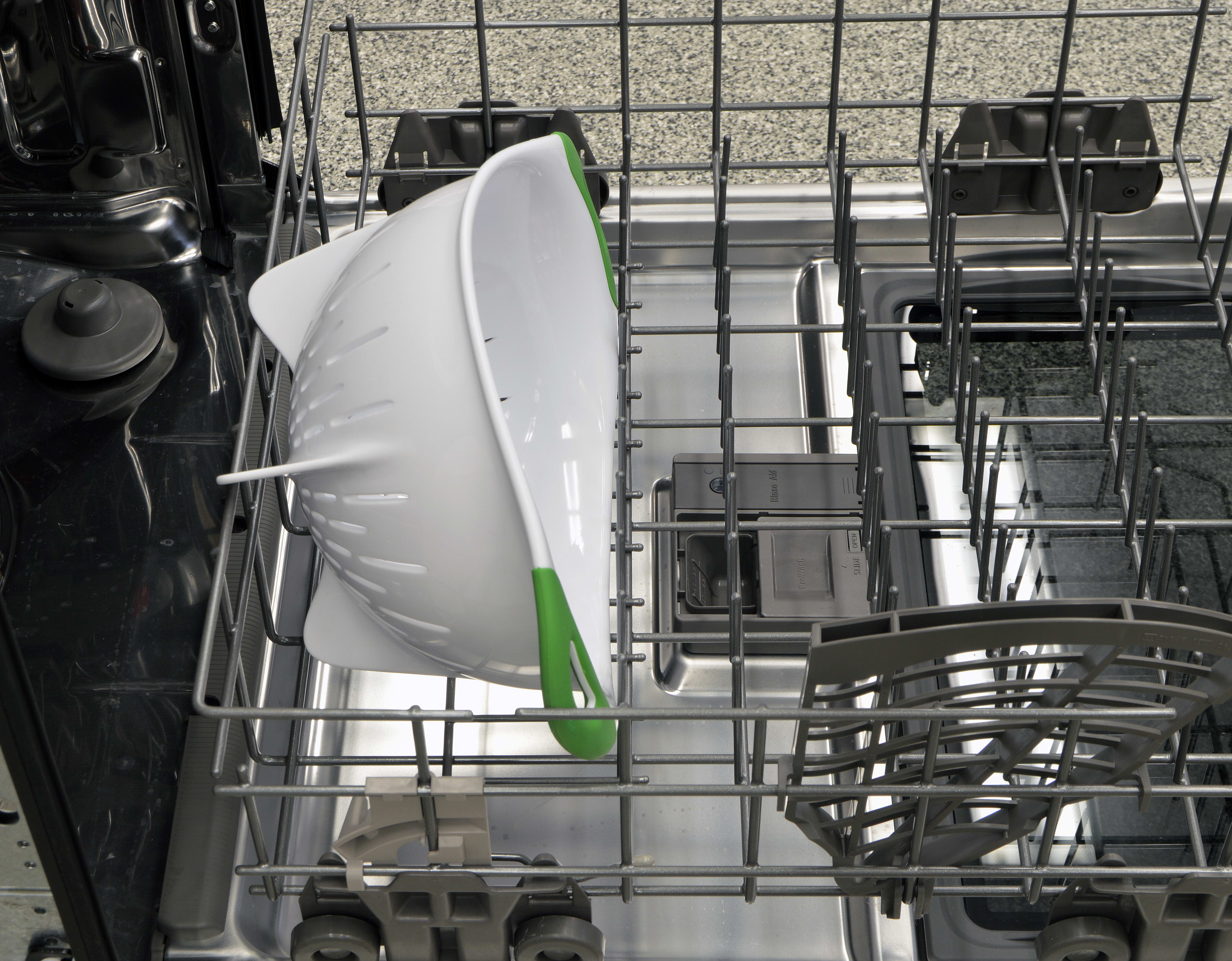 A large colander loaded on the lower rack