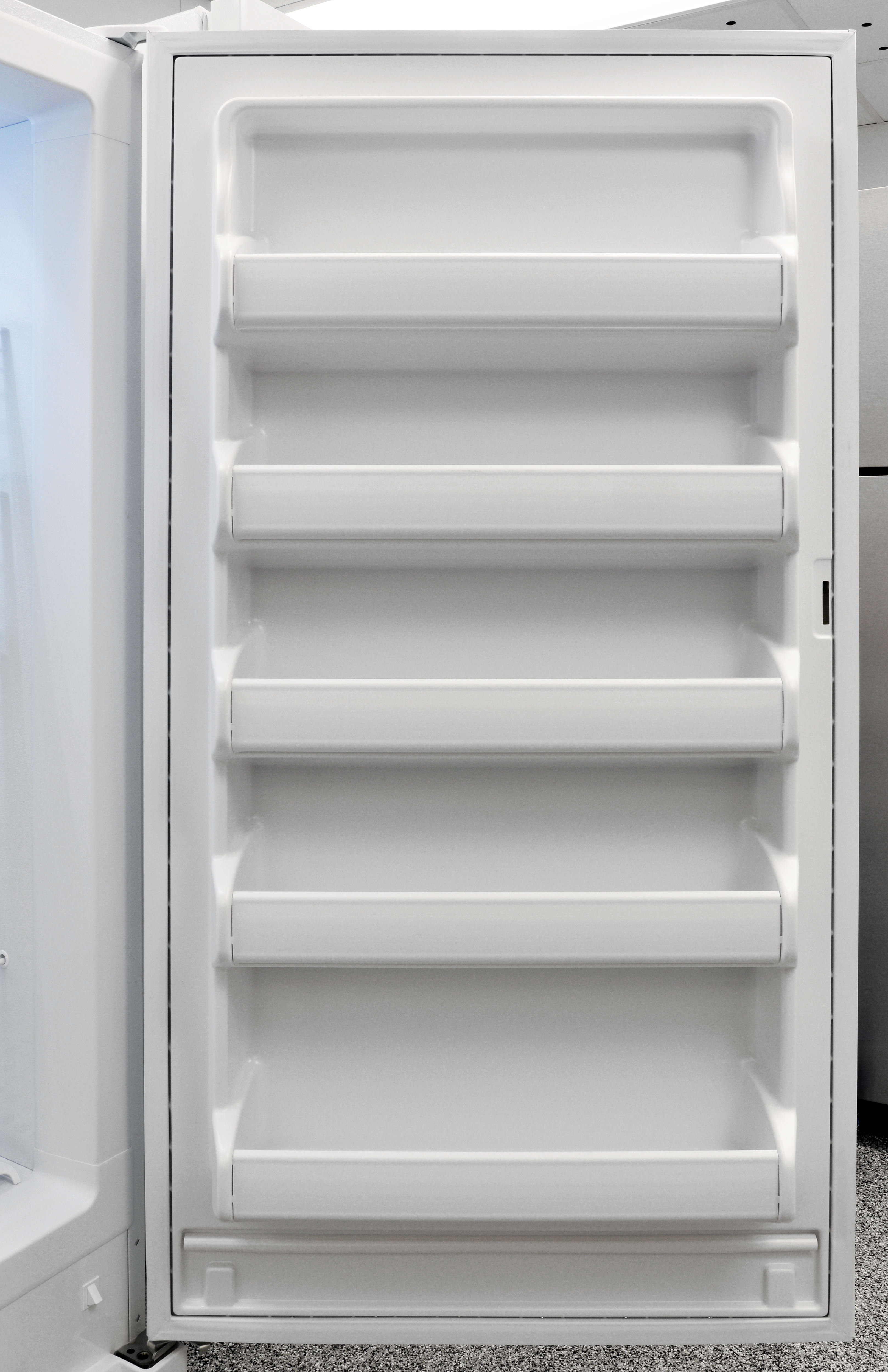 The Frigidaire FFFH17F2QW's door has even more shelves than the main section, but none of them move.