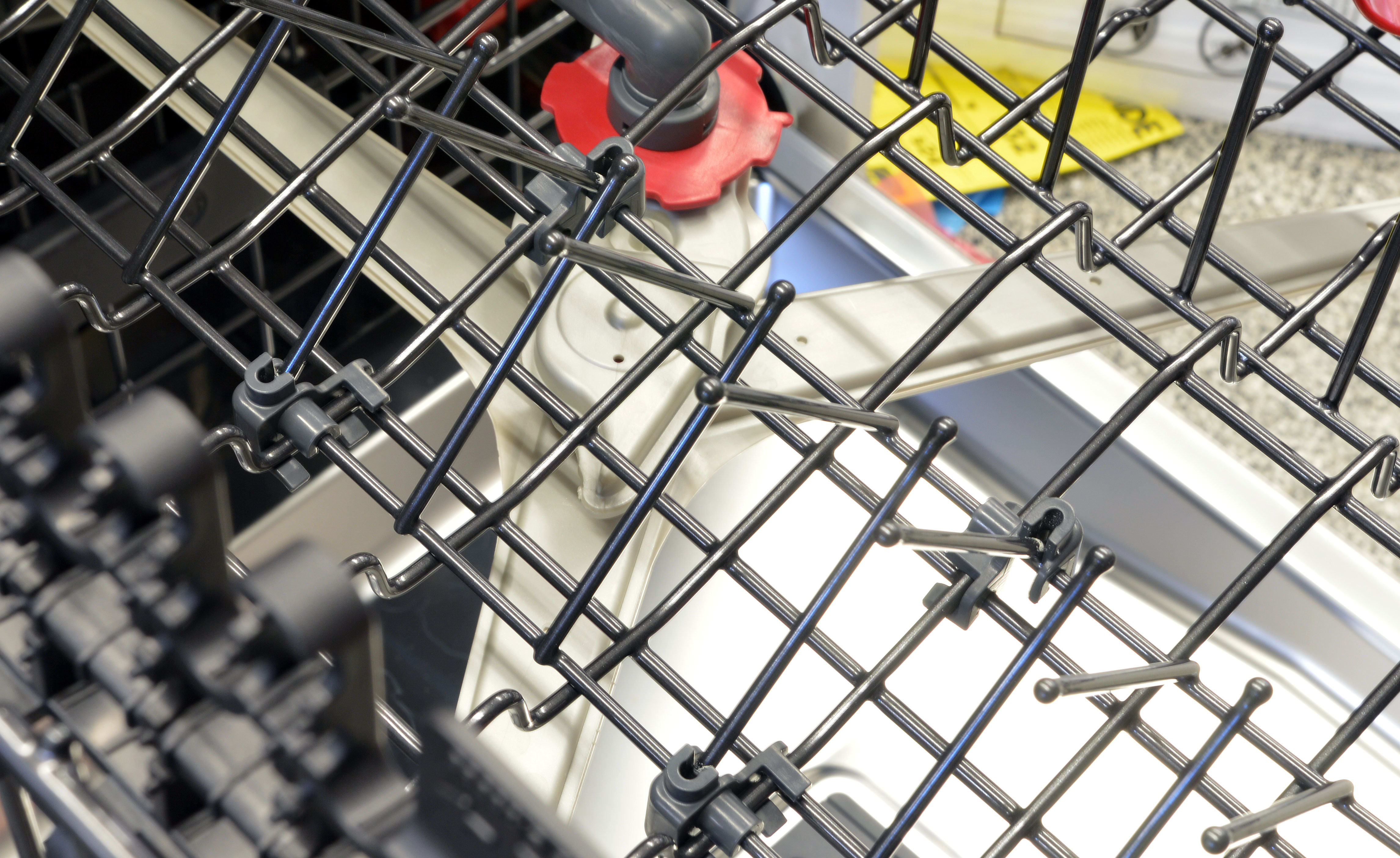 Two of the four rows of tines on the upper rack can fold down to accommodate larger items.