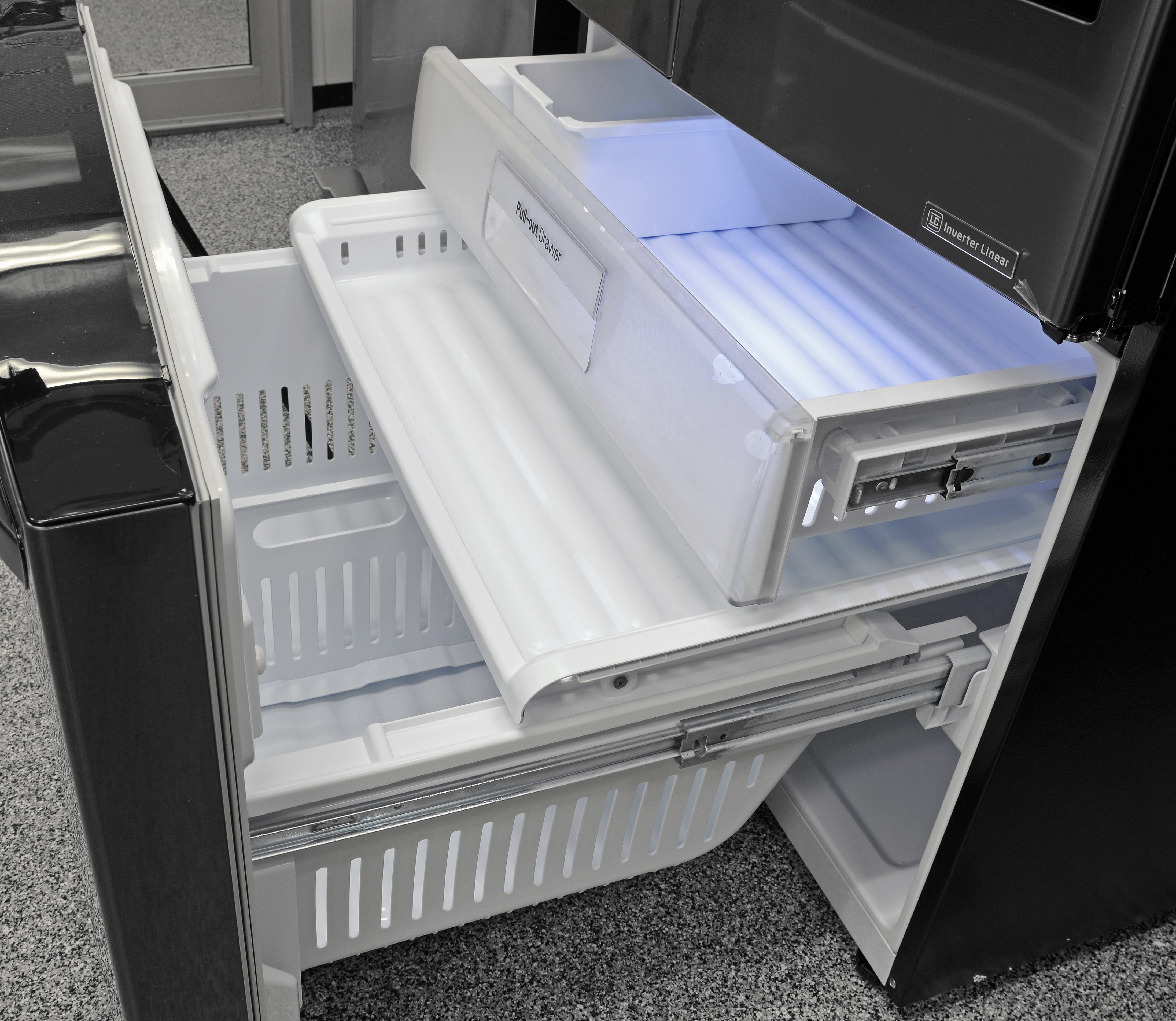 The freezer has three pull-out drawers, as well as a bucket for storing loose items or hoarding bulk ice.