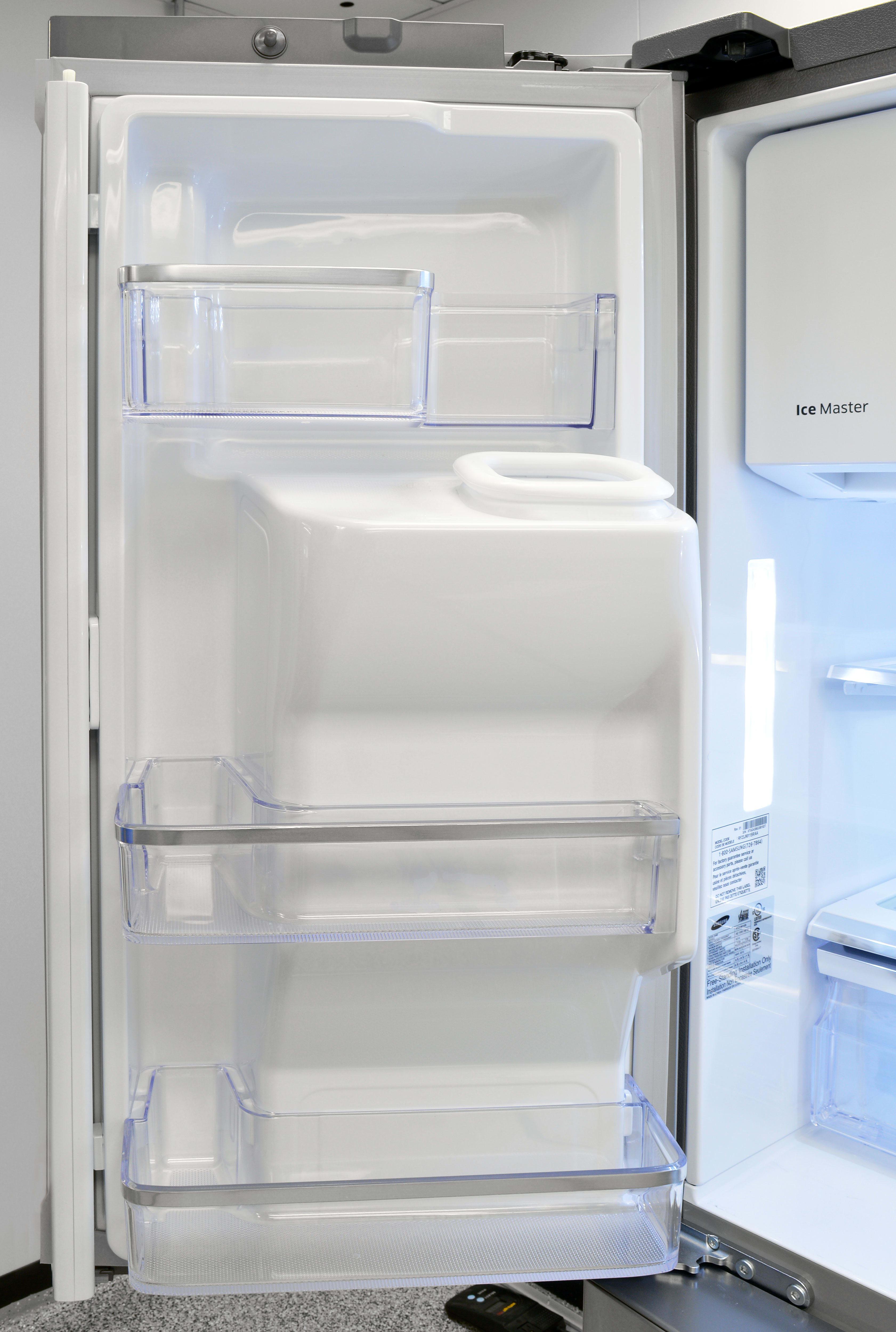 The Samsung RF23J9011SR's left door plays host to the icemaker's dispenser chute.