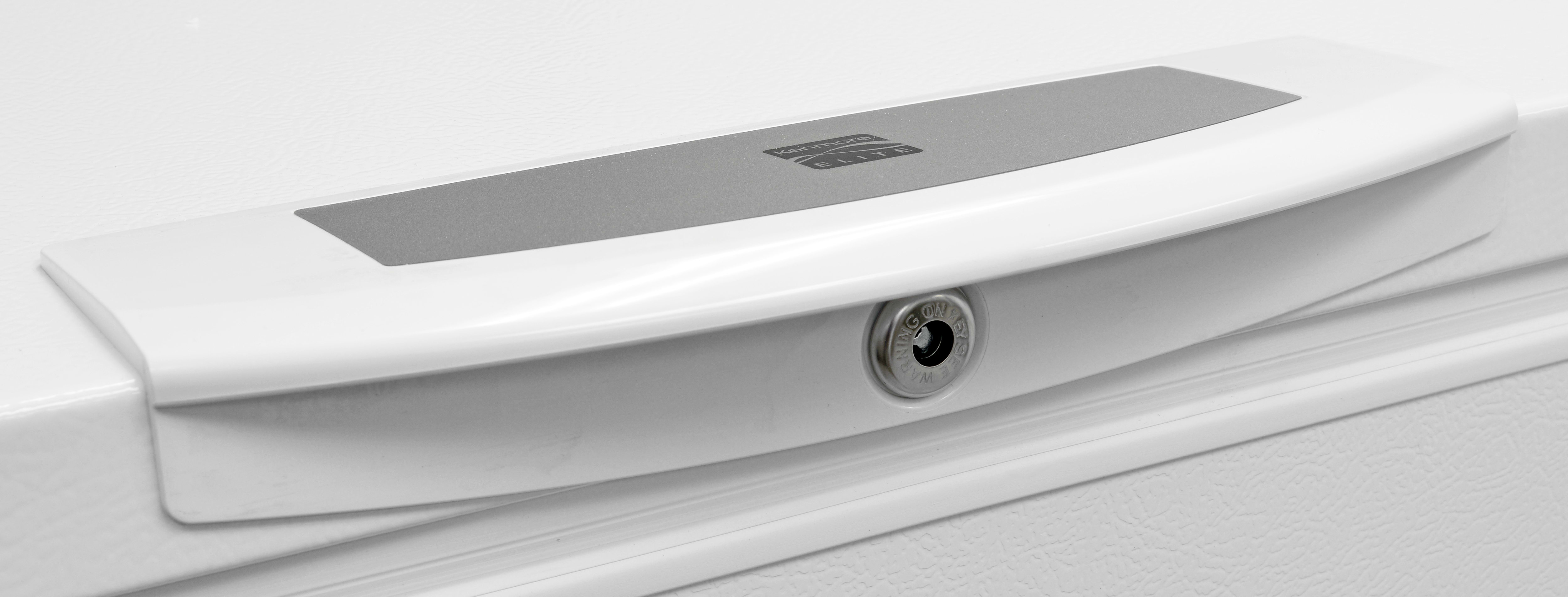 A traditional door lock helps keep the Kenmore Elite 17202's heavy lid in place.