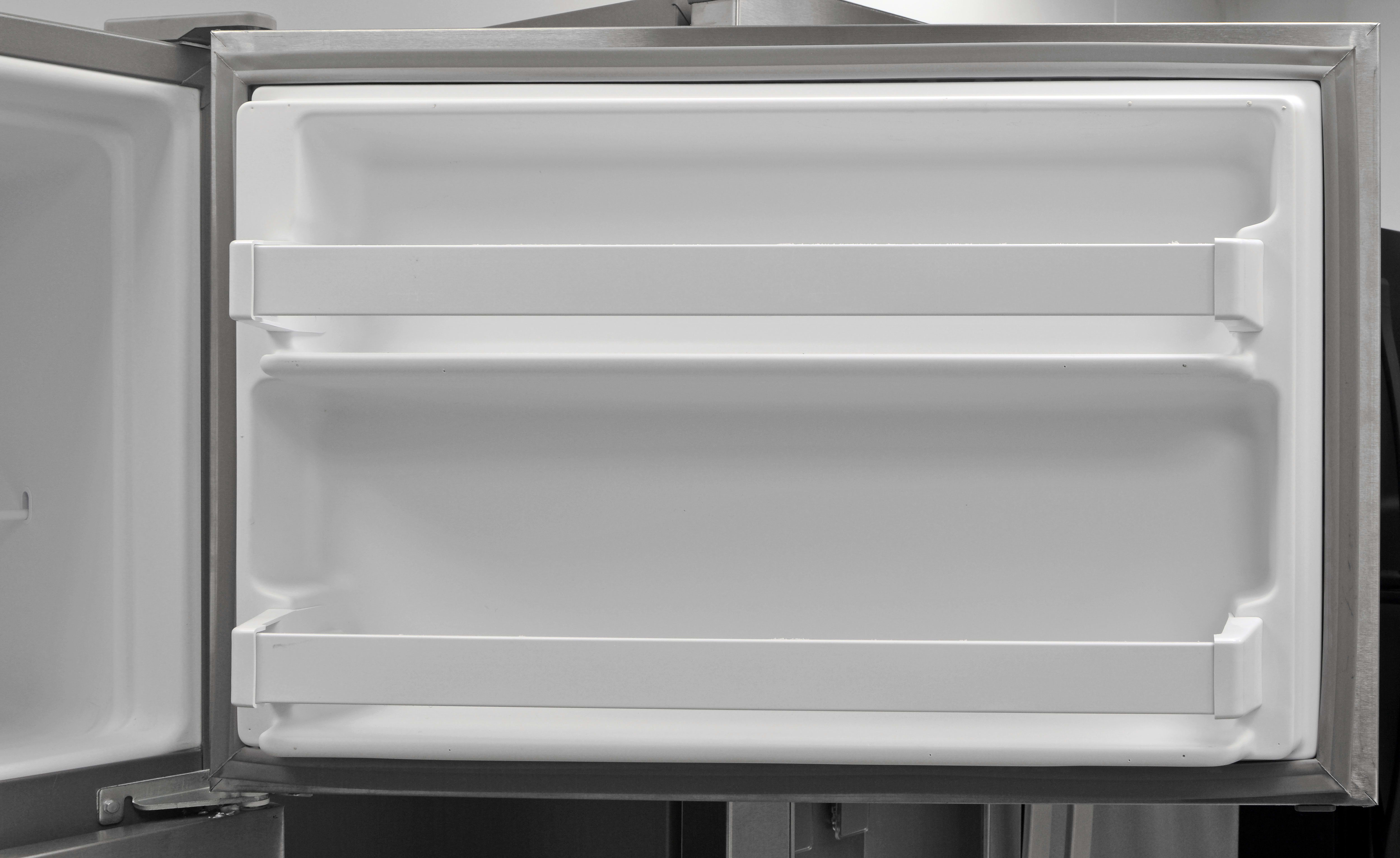 What makes up essentially every freezer door on a budget fridge like the Whirlpool WRT311FZDM? Two basic fixed shelves.