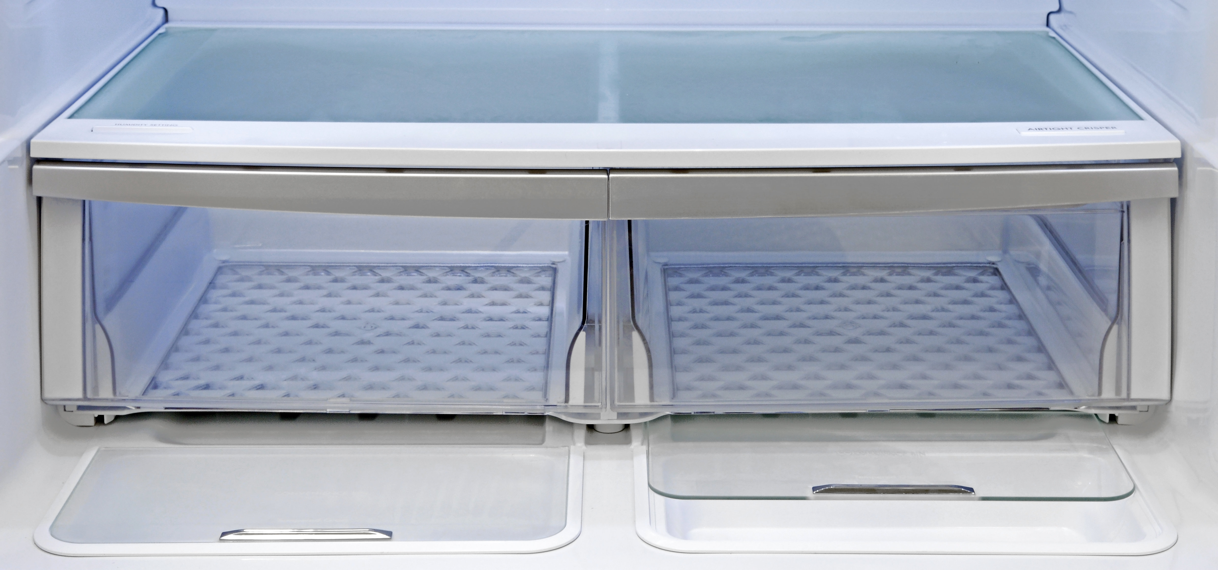 Both of the Kenmore Elite 72483's crispers are roomy and slide with ease. Plus, recessed into the bottom of the fridge compartment right in front of the crispers, you find two extra storage areas.
