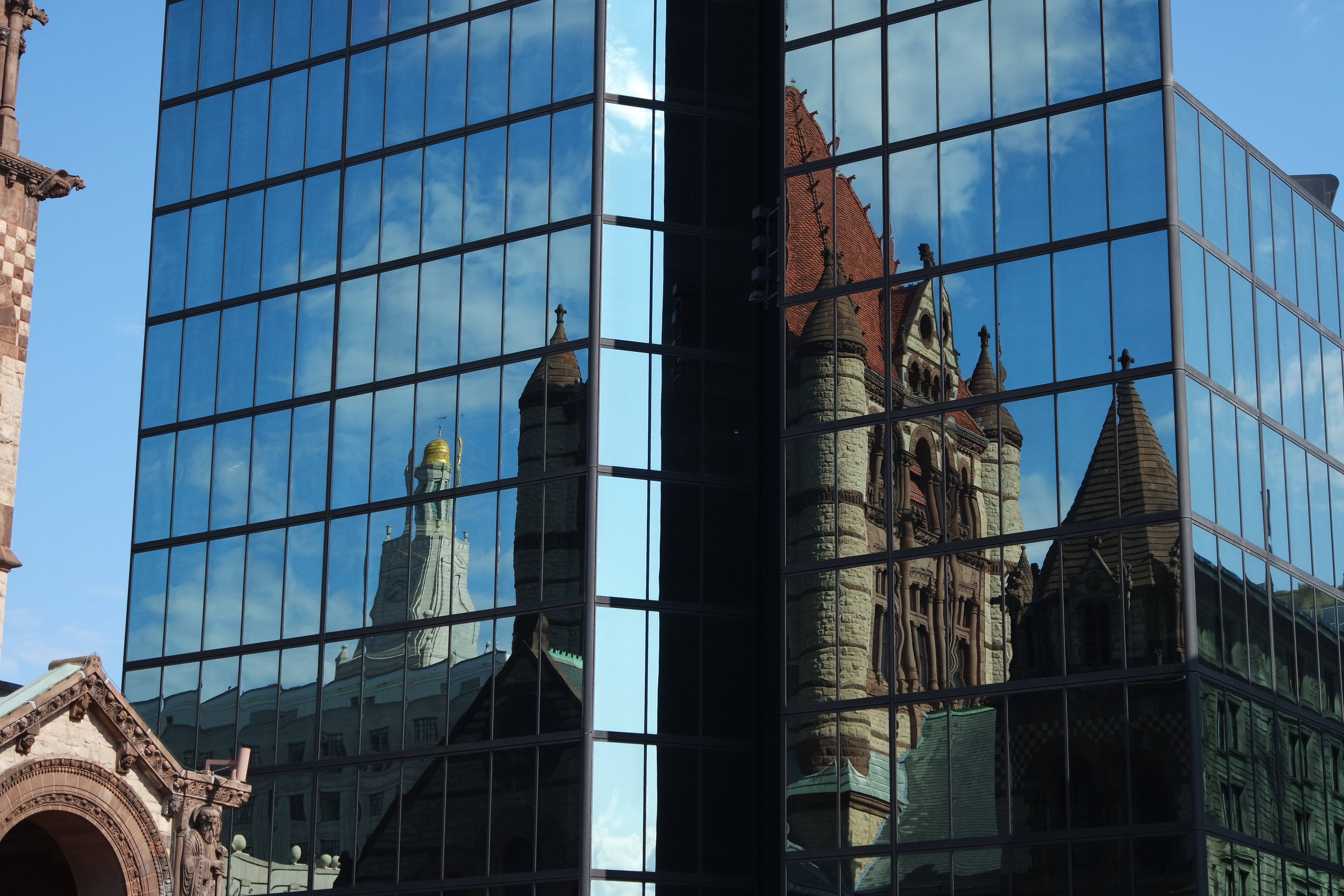 A sample photo of a church reflected in the Hancock building shot by the Samsung NX3000.