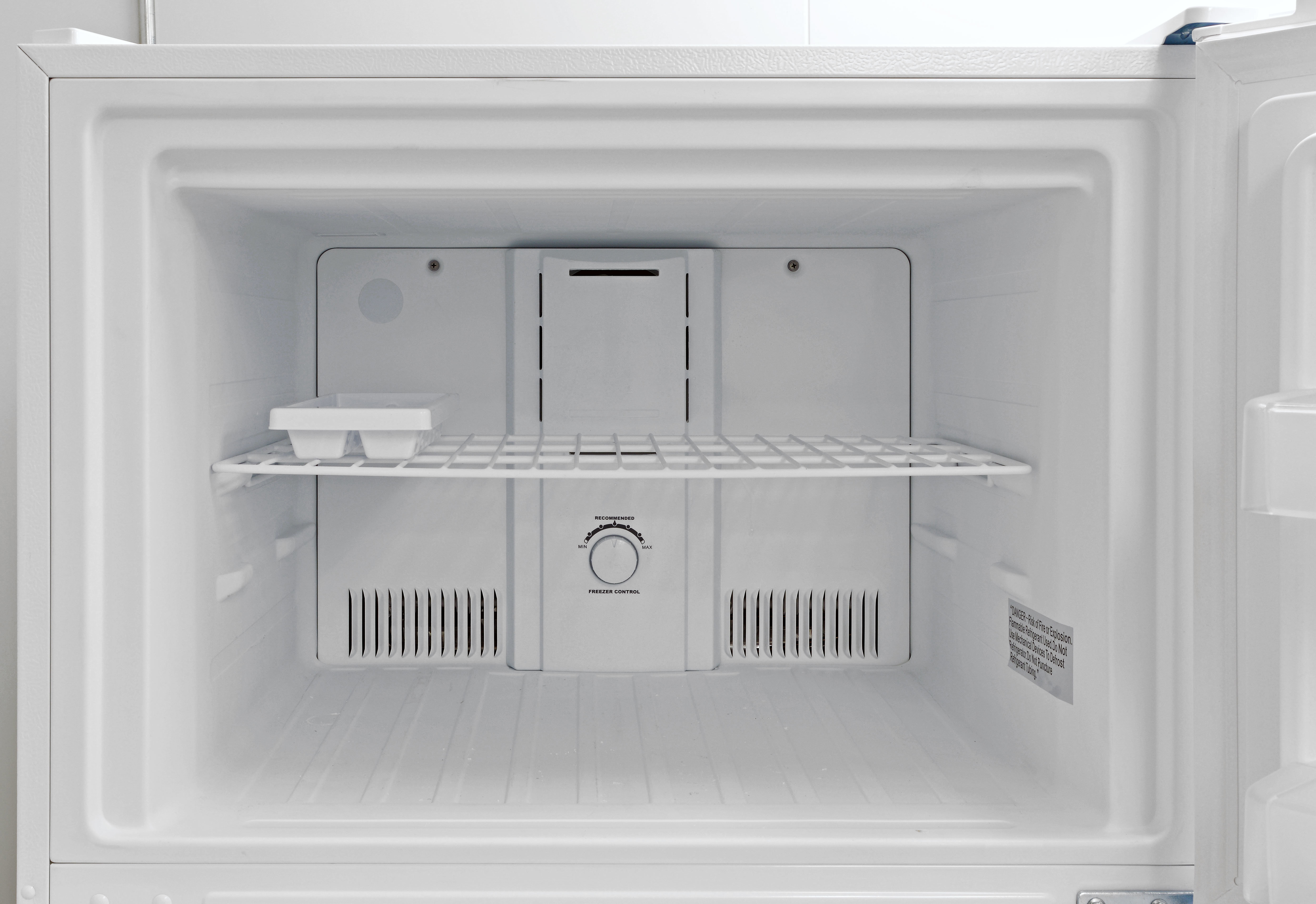 No light, no ice maker, just one adjustable wire shelf. Oh, and an ice cube tray.