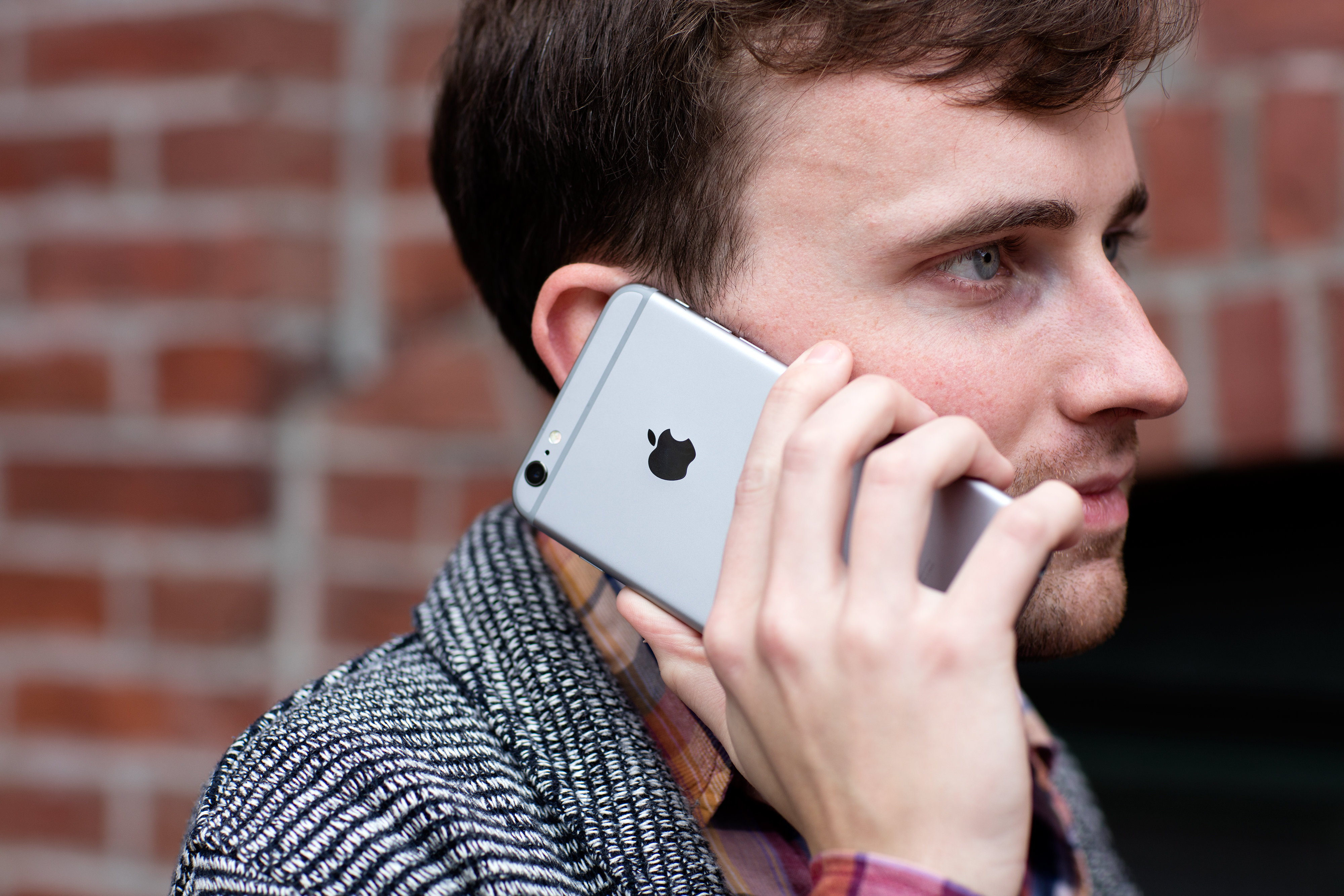 A person taking a call on the iPhone 6s Plus