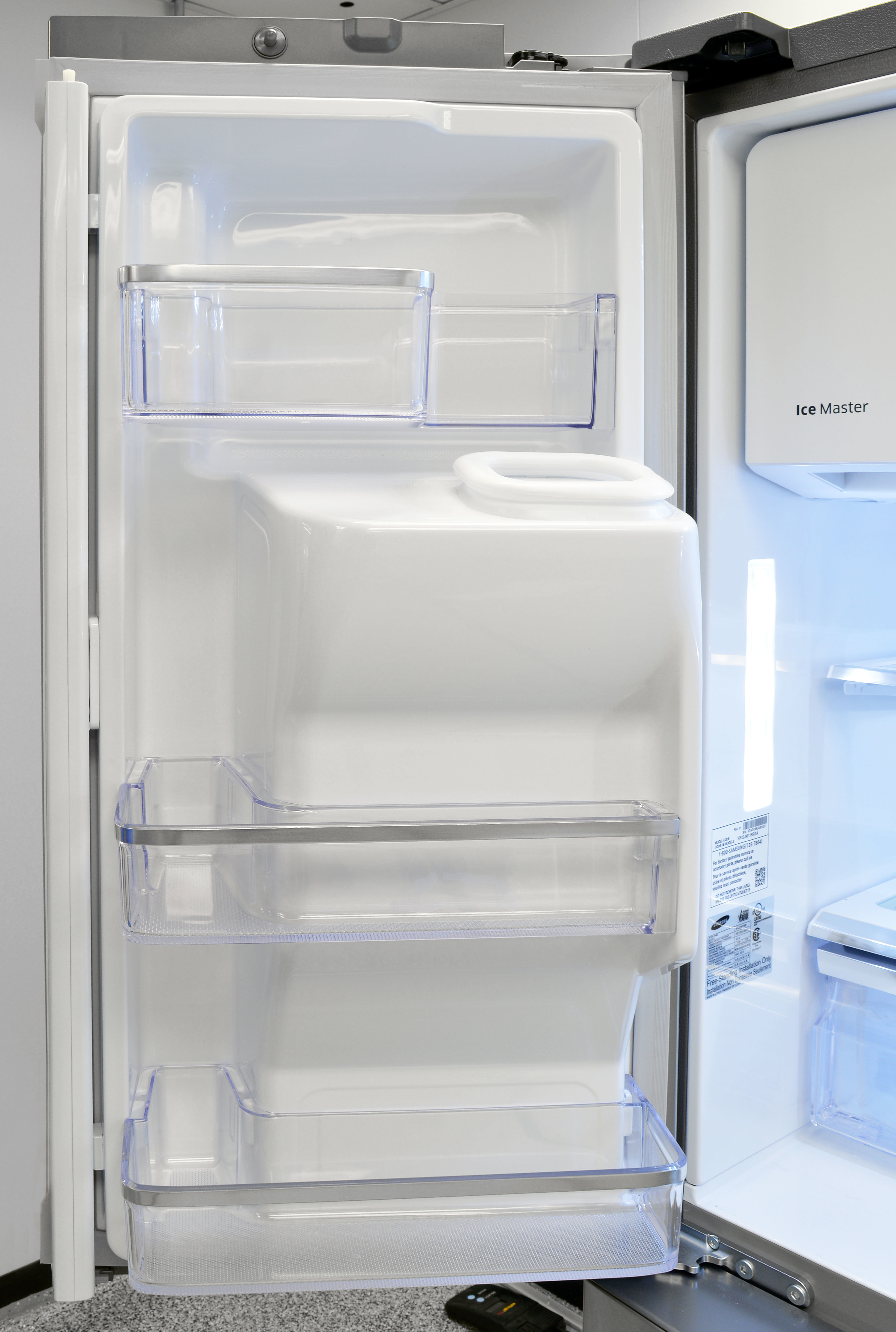 The Samsung RF23J9011SR's left door plays host to the icemaker's dispenser chute.