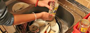 Hand washing dishes hero