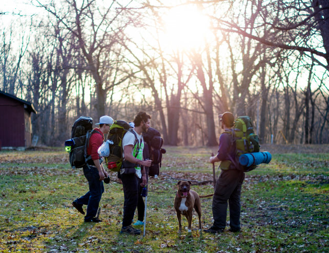 People hiking with a dog