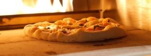 Kalamazoo pizza in oven hero